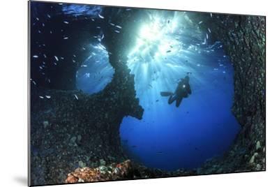 Scuba Diver Swimming through an Arch-Bernard Radvaner-Mounted Photographic Print