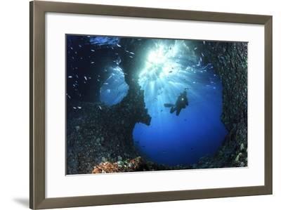 Scuba Diver Swimming through an Arch-Bernard Radvaner-Framed Photographic Print