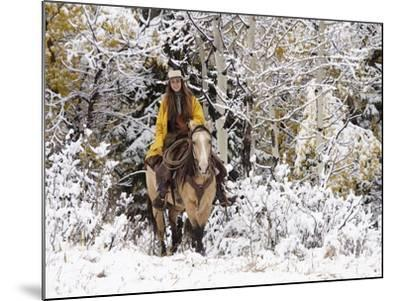 Cowgirl Riding in Autumn Aspens with a Fresh Snowfall-Terry Eggers-Mounted Photographic Print