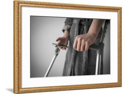 Person on Crutches Texting-Anthony West-Framed Photographic Print