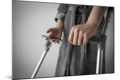 Person on Crutches Texting-Anthony West-Mounted Photographic Print