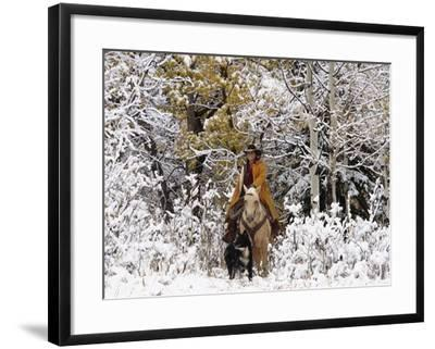 Cowgirl Riding in Autumn Aspens with a Fresh Snowfall-Terry Eggers-Framed Photographic Print