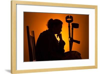 Woman Seated with Crutches-Anthony West-Framed Photographic Print