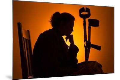Woman Seated with Crutches-Anthony West-Mounted Photographic Print