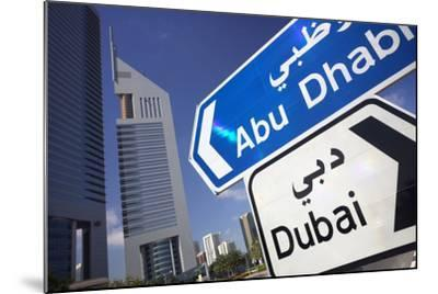 Direction Signs on Sheikh Zayed Road in Dubai-Jon Hicks-Mounted Photographic Print