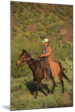 Cowboy Riding a Horse-DLILLC-Mounted Photographic Print