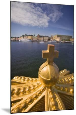 An Ornamental Crown of the Skeppsholmsbron, with Gamla Stan across the Water-Jon Hicks-Mounted Photographic Print