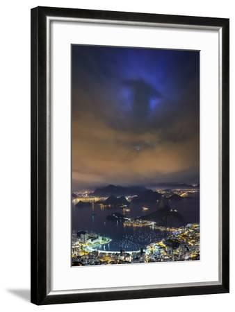 The Shadow of Christ the Redeemer Projected on to Clouds above Rio De Janeiro.-Jon Hicks-Framed Photographic Print