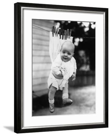 Baby (6-11 Months) Attached to Clothesline--Framed Photographic Print