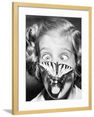 Butterfly Perched on Girl's Nose--Framed Photographic Print