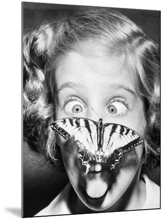 Butterfly Perched on Girl's Nose--Mounted Photographic Print