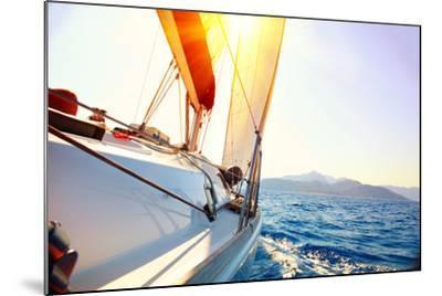 Yacht Sailing Against Sunset. Sailboat. Yachting. Sailing. Travel Concept. Vacation-Subbotina Anna-Mounted Photographic Print