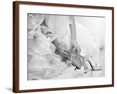 The Bride is Putting on Her Shoes for the Wedding Day-szefei-Framed Photographic Print