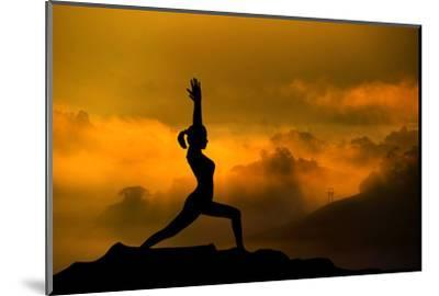 Silhouette of Woman Doing Yoga Meditation During Sunrise with Natural Golden Sunlight on Mountain-szefei-Mounted Photographic Print