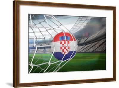 Football in Croatia Colours at Back of Net against Large Football Stadium with Lights-Wavebreak Media Ltd-Framed Photographic Print