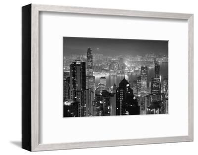 Hong Kong City Skyline at Night with Victoria Harbor and Skyscrapers Illuminated by Lights over Wat-Songquan Deng-Framed Photographic Print