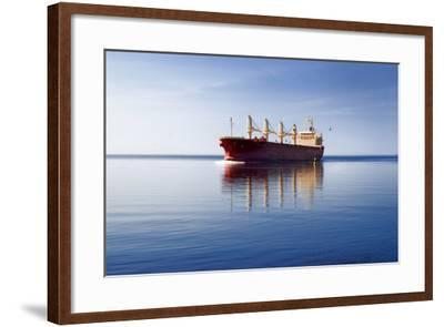 Cargo Ship Sailing in Still Water-aleksey.stemmer-Framed Photographic Print