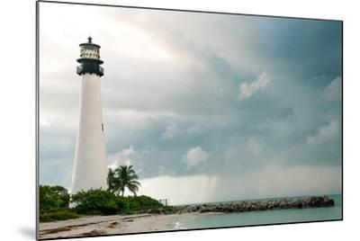Lighthouse in a Cloudy Day with a Storm Approaching-Santiago Cornejo-Mounted Photographic Print