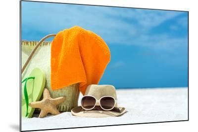 Summer Beach Bag with Coral,Towel and Flip Flops on Sandy Beach-oleggawriloff-Mounted Photographic Print
