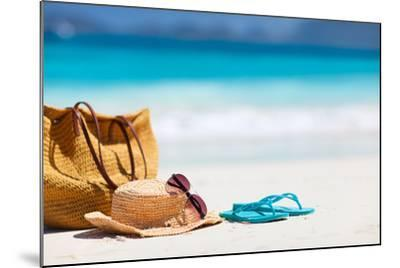 Straw Hat, Bag, Sun Glasses and Flip Flops on a Tropical Beach-BlueOrange Studio-Mounted Photographic Print