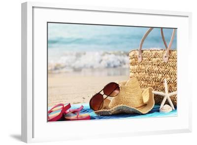 Summer Beach Bag with Straw Hat,Towel,Sunglasses and Flip Flops on Sandy Beach-Sofiaworld-Framed Photographic Print