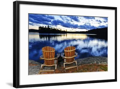 Landscape with Adirondack Chairs on Shore of Relaxing Lake at Sunset in Algonquin Park, Canada-elenathewise-Framed Photographic Print