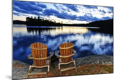 Landscape with Adirondack Chairs on Shore of Relaxing Lake at Sunset in Algonquin Park, Canada-elenathewise-Mounted Photographic Print