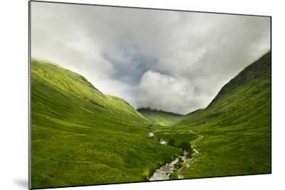 River Flowing through a Valley in the Scottish Highlands, the Mountains are Covered in Clouds-unkreatives-Mounted Photographic Print