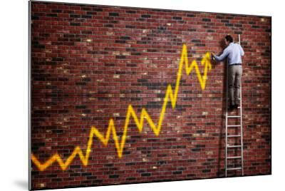 Businessman Standing on a Ladder and Drawing a Graph with Positive Trend in Graffiti Style Yellow S-Flynt-Mounted Photographic Print