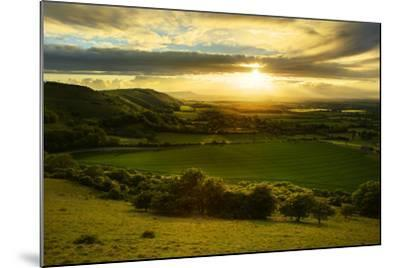 Stunning Countryside Landscape with Sun Lighting Side of Hills at Sunset-Veneratio-Mounted Photographic Print