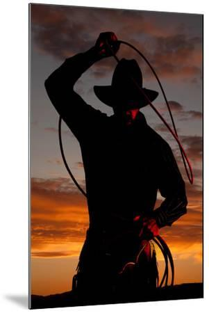 Cowboy in Sunset with Rope-Alan and Vicena Poulson-Mounted Photographic Print