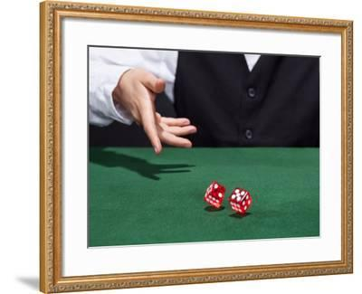 Croupier Throwing A Pair of Dice-AndreyPopov-Framed Photographic Print