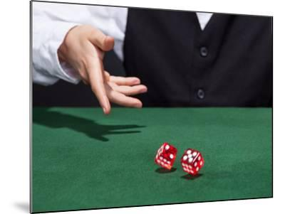 Croupier Throwing A Pair of Dice-AndreyPopov-Mounted Photographic Print
