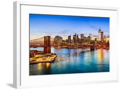 New York City, USA Skyline over East River and Brooklyn Bridge.-SeanPavonePhoto-Framed Photographic Print