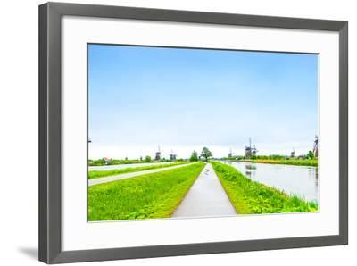 Windmills and Canals in Kinderdijk, Holland or Netherlands. Unesco Site-stevanzz-Framed Photographic Print
