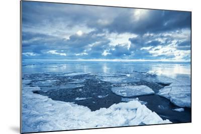Winter Coastal Landscape with Floating Melting Ice Fragments-Eugene Sergeev-Mounted Photographic Print