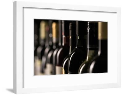 Row of Vintage Wine Bottles in a Wine Cellar (Shallow Dof; Color Toned Image)-l i g h t p o e t-Framed Photographic Print