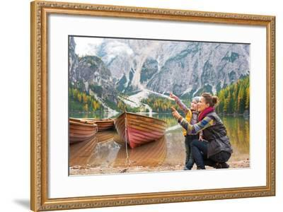Happy Mother and Baby Pointing on Copy Space While on Lake Braies in South Tyrol, Italy-Mr Alliance-Framed Photographic Print
