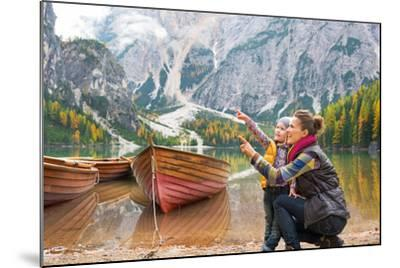 Happy Mother and Baby Pointing on Copy Space While on Lake Braies in South Tyrol, Italy-Mr Alliance-Mounted Photographic Print