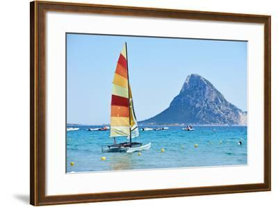 Scenic Italy Sardinia Beach Resort Landscape with Sail Boat and Mountains-kadmy-Framed Photographic Print