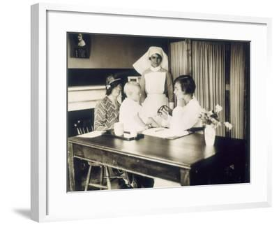 Doctor Examines a Baby at a Dispensary--Framed Photographic Print