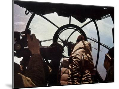 German Machine-Gunner in the Cockpit of a Bomber, Probably a Heinkel He-111-Unsere Wehrmacht-Mounted Photographic Print
