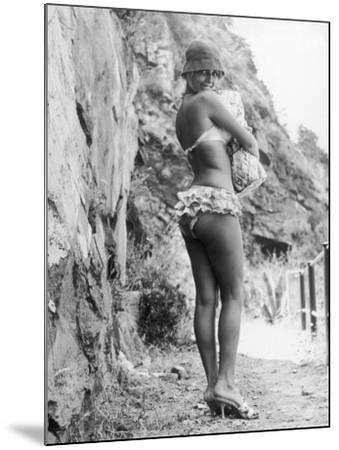Girl in Bikini Walks Along a Cliff Path on a Fine Summer Day--Mounted Photographic Print