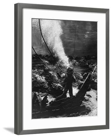 The First Photograph of a Diver at the Bottom of the Sea--Framed Photographic Print