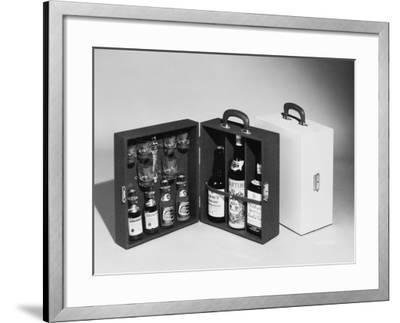 A Handy Case Containing Whisky, Martini and Gin, Mixers, a Bottle Opener and Glasses!--Framed Photographic Print