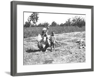 Father and Child in a Field, India--Framed Photographic Print