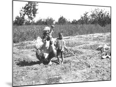 Father and Child in a Field, India--Mounted Photographic Print