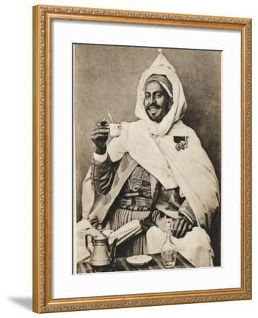 A Decorated Moroccan Tribal Chief Enjoying a Cup of Coffee--Framed Photographic Print