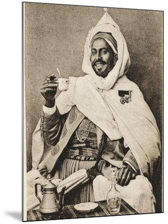 A Decorated Moroccan Tribal Chief Enjoying a Cup of Coffee--Mounted Photographic Print