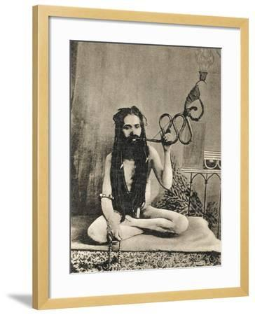 A Sadhu Smoking a Remarkable Pipe, India--Framed Photographic Print